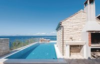 Stone holiday house with land on island Korcula